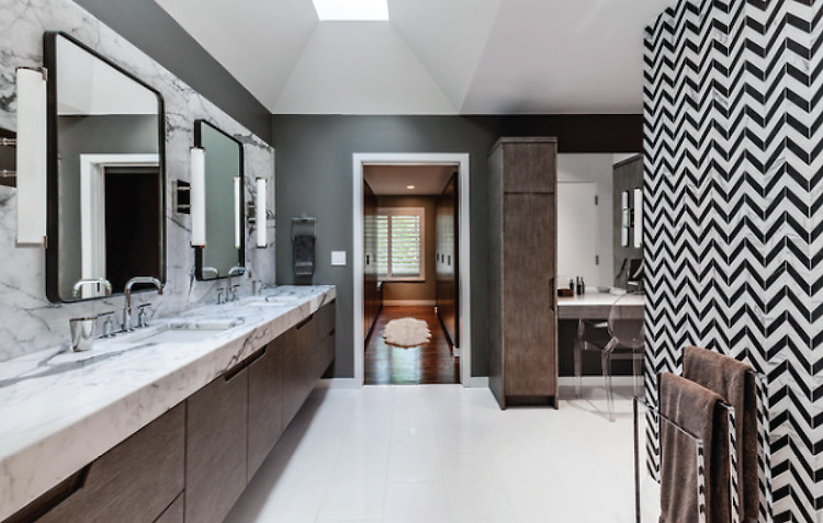 This custom bathroom features Maharaja Stripe, a handmade mosaic, shown in Nero Marquina and Calacatta Tia from the Silk Road collection by Sara Baldwin for New Ravenna.<br /> -photo courtesy of KICK Interiors LLC<br /> <br /> For pricing samples and design help, click here: http://www.newravenna.com/showrooms/