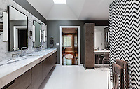 This custom bathroom features Maharaja Stripe, a handmade mosaic, shown in Nero Marquina and Calacatta Tia from the Silk Road collection by Sara Baldwin for New Ravenna.<br />
