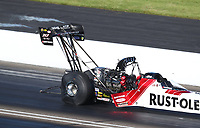 Jul 12, 2020; Clermont, Indiana, USA; Contrails come off the rear wing on the dragster of NHRA top fuel driver T.J. Zizzo during the E3 Spark Plugs Nationals at Lucas Oil Raceway. This is the first race back for NHRA since the start of the COVID-19 global pandemic. Mandatory Credit: Mark J. Rebilas-USA TODAY Sports