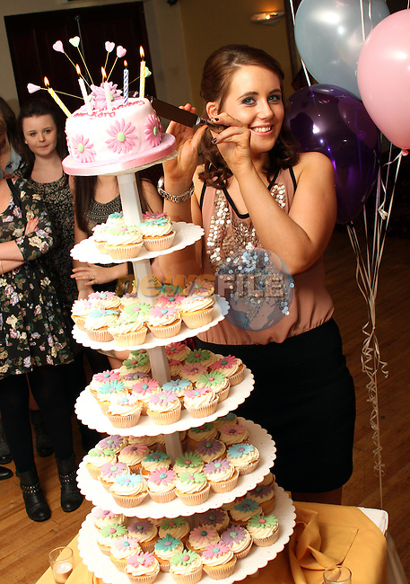 Sarah Morris cuts her cake at her 21st in The Glenside Hotel...(Photo credit should read Jenny Matthews www.newsfile.ie)....This Picture has been sent you under the conditions enclosed by:.Newsfile Ltd..The Studio,.Millmount Abbey,.Drogheda,.Co Meath..Ireland..Tel: +353(0)41-9871240.Fax: +353(0)41-9871260.GSM: +353(0)86-2500958.email: pictures@newsfile.ie.www.newsfile.ie.