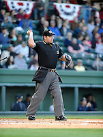 Umpire Jorge Teran officiates in a game between the Greenville Drive and Charleston River Dogs on Opening Day, Friday, April 5, 2013, at Fluor Field at the West End in Greenville, South Carolina. Greenville won, 4-2. (Tom Priddy/Four Seam Images)