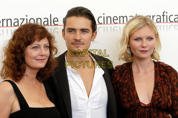 "SUSAN SARANDON, ORLANDO BLOOM & KIRSTEN DUNST.Photocall for the film ""Elizabethtown"",.62nd International Film Festival,.Venice, 4th September 2005.portrait headshot black jacket dress red floral pattern v-neck goatie beard mustache.www.capitalpictures.com.sales@capitalpictures.com.© Capital Pictures."