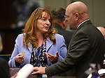 Nevada Assembly Minority Leader Marilyn Kirkpatrick, D-North Las Vegas, and Assemblyman Ira Hansen, R-Sparks, talk on the Assembly floor at the Legislative Building in Carson City, Nev., on Monday, April 6, 2015. <br /> Photo by Cathleen Allison