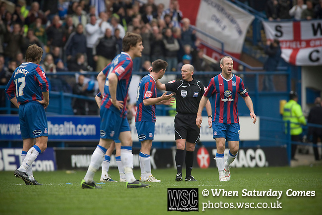 Crystal Palace players protesting to referee Mike Dean about Sheffield Wednesday's Alan Lee's equalising goal at Hillsborough during the crucial last-day relegation match. The match ended in a 2-2 draw which meant Wednesday were relegated to League 1. Crystal Palace remained in the Championship despite having been deducted 10 points for entering administration during the season.