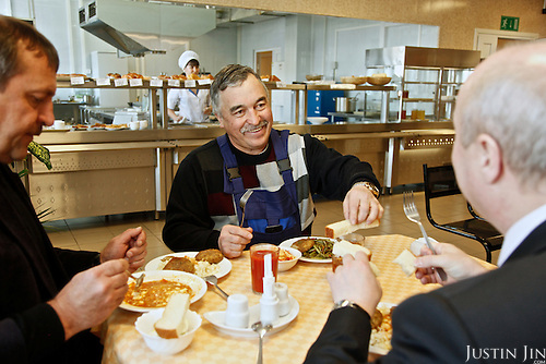 Manager Varvaz lunches with Sergei Vlasov (back of head) at Achimgaz in Novy Urengoi, Siberia, Russia.
