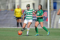 8 November 2015:  North Texas Defender Molly Grisham (6) advances the ball with Marshall Forward Mack Moore (10) in pursuit in the second half as the University of North Texas Mean Green defeated the Marshall University Thundering Herd, 1-0, in the Conference USA championship game at University Park Stadium in Miami, Florida.