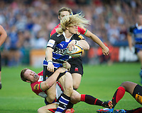 20120803 Copyright onEdition 2012©.Free for editorial use image, please credit: onEdition..Tom Biggs of Bath Rugby is tackled by Peceli Nacamavuto (right) and Hamish Smales of London Welsh at The Recreation Ground, Bath in the Final round of The J.P. Morgan Asset Management Premiership Rugby 7s Series...The J.P. Morgan Asset Management Premiership Rugby 7s Series kicked off again for the third season on Friday 13th July at The Stoop, Twickenham with Pool B being played at Edgeley Park, Stockport on Friday, 20th July, Pool C at Kingsholm Gloucester on Thursday, 26th July and the Final being played at The Recreation Ground, Bath on Friday 3rd August. The innovative tournament, which involves all 12 Premiership Rugby clubs, offers a fantastic platform for some of the country's finest young athletes to be exposed to the excitement, pressures and skills required to compete at an elite level...The 12 Premiership Rugby clubs are divided into three groups for the tournament, with the winner and runner up of each regional event going through to the Final. There are six games each evening, with each match consisting of two 7 minute halves with a 2 minute break at half time...For additional images please go to: http://www.w-w-i.com/jp_morgan_premiership_sevens/..For press contacts contact: Beth Begg at brandRapport on D: +44 (0)20 7932 5813 M: +44 (0)7900 88231 E: BBegg@brand-rapport.com..If you require a higher resolution image or you have any other onEdition photographic enquiries, please contact onEdition on 0845 900 2 900 or email info@onEdition.com.This image is copyright the onEdition 2012©..This image has been supplied by onEdition and must be credited onEdition. The author is asserting his full Moral rights in relation to the publication of this image. Rights for onward transmission of any image or file is not granted or implied. Changing or deleting Copyright information is illegal as specified in the Copyright, Design and Patents Act 1988. If you are in any way unsur