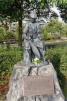 Black bronze Japanese Fishermen's Memorial statue in the Britannia Heritage Shipyard, Steveston, Richmond, British Columbia, Canada