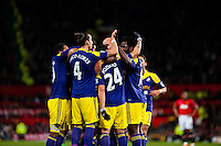 Sunday 05 January 2014<br /> Pictured:Wayne Routledge celebrates with team mates after scoring against Man Utd <br /> Re: Manchester Utd FC v Swansea City FA cup third round match at Old Trafford, Manchester