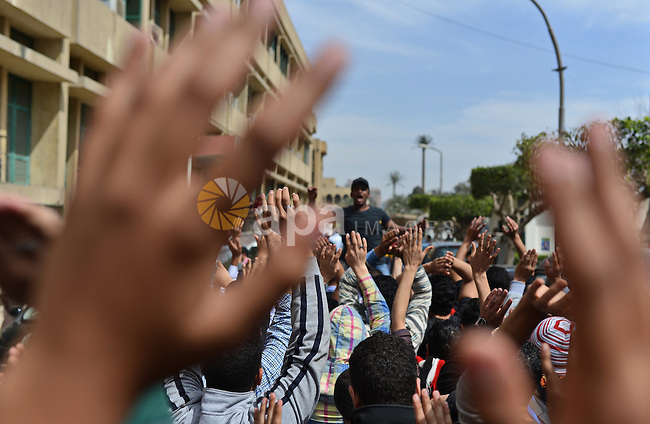 Egyptian students who are support ousted President Mohamed Morsi and the Muslim Brotherhood shout slogans during protest against the military rule, in Cairo University on March 8, 2015. Photo by Amr Sayed