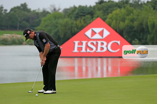 Graeme McDowell (NIR) putts on the 9th green during Thursday's Round 1 of the 2013 WGC-HSBC Champions held at the Sheshan International Golf Club, Shanghai, China. 31st October 2013.<br /> Picture: Eoin Clarke/www.golffile.ie
