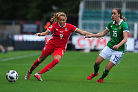 Kayleigh Green of Wales vies for possession with Freya Holdaway of Northern Ireland during the UEFA Womens Euro Qualifier match between Wales and Northern Ireland at Rodney Parade in Newport, Wales, UK. Tuesday 03, September 2019