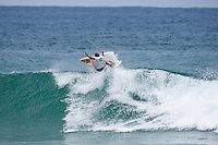 JAMES LEWIS (AUS) scoring a perfect 10 point wave.Burleigh Heads Sunday January 10 2009. The 12th annual Honolua Burleigh Boardriders Single Fin Classic  contest wrapped up today at Burleigh Heads, Queensland, Australia. PAUL WARD (AUS)  was the over all winner with former pro surfers like LUKE EGAN (AUS) and MARK OCCHILUPO (AUS) Photo: joliphotos.com