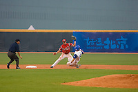 20 August 2007: Second Base #18 Ondrej Petrik takes the throw as #16 Florian Peyrichou slides into second base during the Czech Republic 6-1 victory over France in the Good Luck Beijing International baseball tournament (olympic test event) at the Wukesong Baseball Field in Beijing, China.