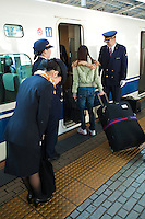 JR Staff Bowing to Passengers - The Shinkansen is a network of high speed railway lines in Japan operated Japan Railways.  Starting with the 210km/h  Shinkansen in 1964 the now 2,500 km long network has expanded to link most major cities on the islands of Honshu and Kyushu at speeds up to 300km/h.