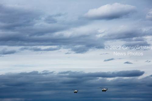 Marine One, carrying United States President Barack Obama and New Jersey Governor Chris Christie, and a second helicopter, Nighthawk Two, fly over storm damage near Atlantic City, New Jersey, Wednesday, October 31, 2012. .Mandatory Credit: Chuck Kennedy - White House via CNP