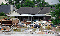 Houses sit in ruin on Sawyer Brown Road located in the Nashville suburb of Bellevue on Friday, May 14, 2010.