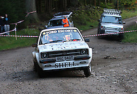 The Opening Car at Junction 6, on Special Stage 1 Craigvinean in the Colin McRae Forest Stages Rally 2012, Round 8 of the RAC MSA Scotish Rally Championship which was organised by Coltness Car Club and based in Aberfeldy on 5.10.12.