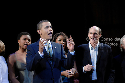 Washington, DC - March 8, 2009 -- United States President Barack Obama (C) joins performers (including James Taylor (R)) on stage to lead in singing 'Happy Birthday' to Senator Ted Kennedy (Democrat- Massachusetts)  at a musical tribute to celebrate Kennedy's birthday at the Kennedy Center in Washington, DC., USA, on Sunday, 08 March 2009..Credit: Chris Usher - Pool via CNP