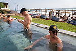 6 DECEMBER, 2019 BALI, INDONESIA:  Mitch Browne (left, 23) and Brendan Erceg (23) from Perth check their phones in the pool at The Lawn beach club in Canggu, Bali. There has been a levelling out of Australian tourist numbers to Bali in recent times and tastes are changing regarding what people want from their holiday. Millennials are being targeted by tourism authorities and they want to give them more boutique experiences than just beach and beer. Picture by Graham Crouch/The Australian