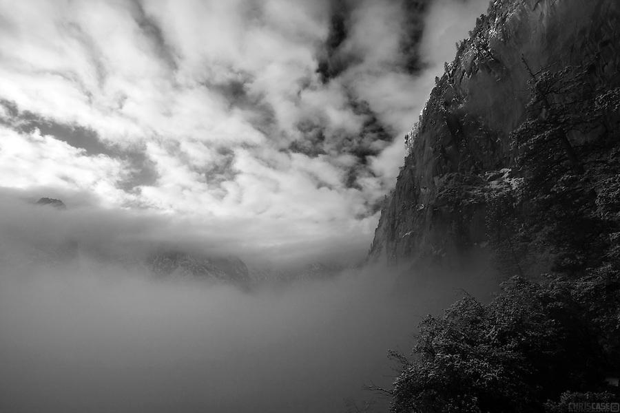 Fog rises from the Yosemite valley to reveal its granite walls, Yosemite National Park, California.