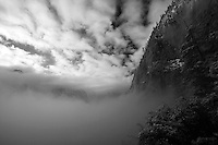 Fog rises from the Yosemite valley to reveal its granite walls, Yosemite National Park, California.