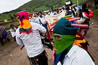 "A man dancer, wearing a colorful masque of Aya Uma - the creature from the Indian myths, leads the procession during the Inti Raymi fiesta in Pichincha province, Ecuador, 26 June 2010. Inti Raymi, ""Festival of the Sun"" in Quechua language, is an ancient spiritual ceremony held in the Indian regions of the Andes, mainly in Ecuador and Peru. The lively celebration, set by the winter solstice, goes on for various days. The highland Indians, wearing beautiful costumes, dance, drink and sing with no rest. Colorful processions in honor of the God Inti (Sun) pass through the mountain villages giving thanks for the harvest and expressing their deep relation to the Mother Earth (Pachamama)."