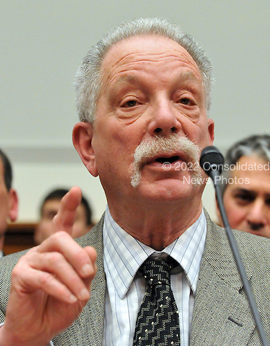 """Washington, DC - January 5, 2009 -- Allan Goldstein, a retiree and investor with Bernard L. Madoff Investment Securities, testifies before the United States House Financial Services Committee on """"assessing the Madoff ponzi scheme and the need for regulatory reform in Washington, DC on Monday, January 5, 2009..Credit: Ron Sachs / CNP.(RESTRICTION: NO New York or New Jersey Newspapers or newspapers within a 75 mile radius of New York City)"""