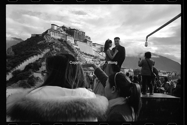 A Chinese couple poses for photos outside the Potala Palace in Lhasa, Tibet, September 2016.