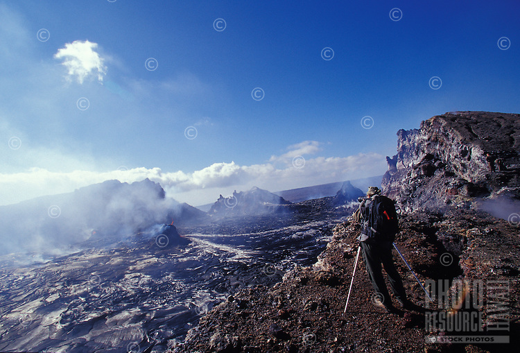 Veteran volcano photographer Brad Lewis filming the eruption of Pu' O'o caldera, Volcanoes National Park
