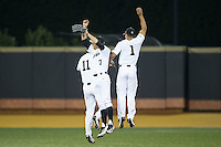 (L-R) Jonathan Pryor (11), Nick DiPonzio (7), and Donnie Sellers (1) celebrate after their win over the USC Trojans at David F. Couch Ballpark on February 24, 2017 in  Winston-Salem, North Carolina.  The Demon Deacons defeated the Trojans 15-5.  (Brian Westerholt/Four Seam Images)
