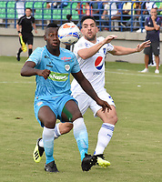 MONTERIA - COLOMBIA, 15-09-2018: Ramon Cordoba (Izq) jugador de Jaguares de Córdoba disputa el balón con Gabriel Hauche (Der) jugador de Millonarios durante partido por la fecha 10 de la Liga Águila II 2018 jugado en el estadio Municipal de Montería. / Ramon Cordoba (L) player of Jaguares of Cordoba vies for the ball with Gabriel Hauche (R) player of Millonarios during a match for the date 10 of the Liga Aguila II 2018 at the Municipal de Monteria Stadium in Monteria city. Photo: VizzorImage / Andres Felipe Lopez / Cont