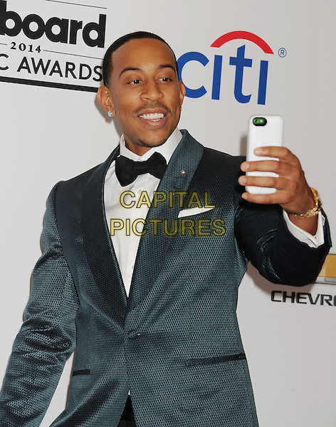 LAS VEGAS, CA- MAY 18: Host/rapper/actor Chris &quot;Ludacris&quot; Bridges poses in the press room at the 2014 Billboard Music Awards at the MGM Grand Garden Arena on May 18, 2014 in Las Vegas, Nevada.<br /> CAP/ROT/TM<br /> &copy;Tony Michaels/Roth Stock/Capital Pictures
