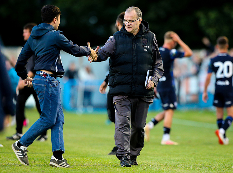 A young Leeds United fan shakes hands with Marcelo Bielsa after the match<br /> <br /> Photographer Alex Dodd/CameraSport<br /> <br /> Football Pre-Season Friendly - Guiseley v Leeds United - Thursday July 11th 2019 - Nethermoor Park - Guiseley<br /> <br /> World Copyright © 2019 CameraSport. All rights reserved. 43 Linden Ave. Countesthorpe. Leicester. England. LE8 5PG - Tel: +44 (0) 116 277 4147 - admin@camerasport.com - www.camerasport.com