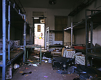 "Ransacked and deserted dormitories in Dingfu Factory in Houjie Town, Dongguan, China. A sign outside the factory that made shoes for Zara and Nine West amongst others, reads that the ""Dongguan People's Court have closed the factory"". As the economy changes and Chinese labour gets more expensive, factories are closing leaving ghost towns behind them..20 Dec 2007"