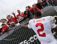 Ohio State Buckeyes running back Rod Smith (2) throws his cap to a fan following the NCAA football game at Ross-Ade Stadium in West Lafayette, IN on Saturday, November 2, 2013. (Columbus Dispatch photo by Jonathan Quilter)