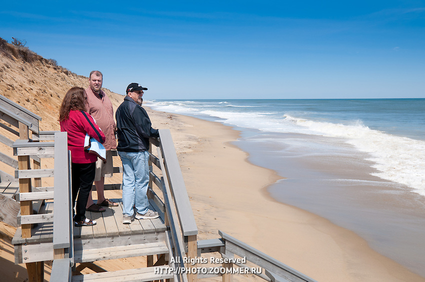 People watching the ocean at stairs of Marconi Beach, Cape Cod