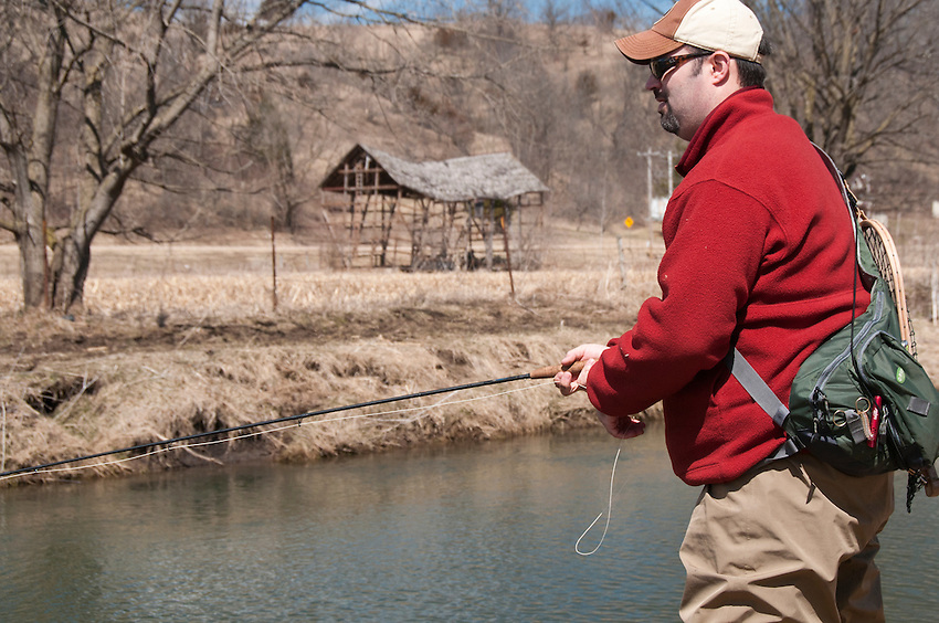 An angler fishes on the Green River a trout stream in the Driftless Area of southwestern Wisconsin.