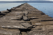 The Rockland Breakwater in Rockland, Maine USA. Completed in 1900 this breakwater is just under a mile long and consists of roughly 700,000 tons of granite. And the Rockland Breakwater Lighthouse is located at the end of it.