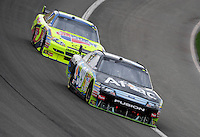 Feb 22, 2009; Fontana, CA, USA; NASCAR Sprint Cup Series driver Carl Edwards leads Mark Martin during the Auto Club 500 at Auto Club Speedway. Mandatory Credit: Mark J. Rebilas-