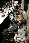 Associated Press Photographer David J. Phillip packs his gear in Think Tank Photo bags after the San Antonio Spurs defeat the Miami Heat at the AT&T Center during the NBA Finals in San Antonio, Texas on Monday, June 16, 2014.   http://www.thinktankphoto.com/default.aspx?code=ap-269