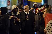"""Ca. 90 Hooligans und Nazis beteiligten sich am Montag den 1. Februar 2016 im Berliner Stadtteil Prenzlauer Berg an einer NPD-Demonstration gegen Asyl und Fluechtlinge. Die aggressive Demonstration wurde von lautstarken Protesten mehrerer hundert Gegendemonstranten begleitet. Die Demonstrationsroute wurde auf Anweisung der Polizei um 2/3 gekuerzt.<br /> Im Bild: Enrico Schottstaedt, Anhaenger des Fussballclub Union Berlin und Organisator der Gruppierung """"Buendnis deutscher Hools"""" (B.D.H.).<br /> 1.2.2016, Berlin<br /> Copyright: Christian-Ditsch.de<br /> [Inhaltsveraendernde Manipulation des Fotos nur nach ausdruecklicher Genehmigung des Fotografen. Vereinbarungen ueber Abtretung von Persoenlichkeitsrechten/Model Release der abgebildeten Person/Personen liegen nicht vor. NO MODEL RELEASE! Nur fuer Redaktionelle Zwecke. Don't publish without copyright Christian-Ditsch.de, Veroeffentlichung nur mit Fotografennennung, sowie gegen Honorar, MwSt. und Beleg. Konto: I N G - D i B a, IBAN DE58500105175400192269, BIC INGDDEFFXXX, Kontakt: post@christian-ditsch.de<br /> Bei der Bearbeitung der Dateiinformationen darf die Urheberkennzeichnung in den EXIF- und  IPTC-Daten nicht entfernt werden, diese sind in digitalen Medien nach §95c UrhG rechtlich geschuetzt. Der Urhebervermerk wird gemaess §13 UrhG verlangt.]"""