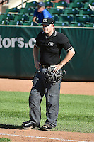 Home plate umpire Ryan Powers between innings as the Idaho Falls Chukars played the Ogden Raptors on July 27, 2014 at Lindquist Field in Ogden, Utah. (Stephen Smith/Four Seam Images)