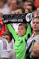 Pictured: A young Swansea supporter with scarf. Saturday 10 September 2011<br />