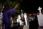 People process through the Pantheon General, which was founded in 1829,  on All Saints Day in Oaxaca, Mexico Nov. 2, 2010.