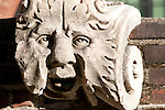 A stone face in the first courtyard of the Sforza Castle in Milan, Italy.