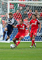 22 May 2010: New England Revolution forward Zack Schilawski #15 and Toronto FC midfielder Nick LaBrocca #21in action during a game between the New England Revolution and Toronto FC at BMO Field in Toronto..Toronto FC won 1-0.....