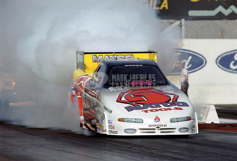 Jan. 2000; Chandler, AZ, USA; NHRA funny car driver Dean Skuza does a burnout during pre season testing at Firebird International Raceway. Mandatory Credit: Mark J. Rebilas-