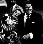 "40th President of the United States Ronald Wilson Reagan with wife Nancy hold their dog, Ronald Reagan was 33rd Governor of California began a career as an actor first in films then television appearing in 52 movie productions served as president of the Screen Actors Guild originally a member of the Democratic Party switched to the Republican Party in 1962, President Reagan implemented sweeping new political and economic initiatives supply-side economic policies dubbed ""Reaganomics"" controlling the money supply to reduce inflation and spurring economic growth by reducing tax rates took a hard line against labor unions and ending of Cold War,"