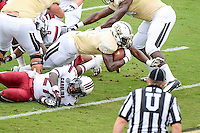 September 28, 2013 - Orlando, FL, U.S: UCF Knights running back Storm Johnson (8) dives over South Carolina Gamecocks cornerback Victor Hampton (27) to score  during 1st half NCAA football game action between the South Carolina Gamecocks and the UCF Knights at Bright House Networks Stadium in Orlando, Fl